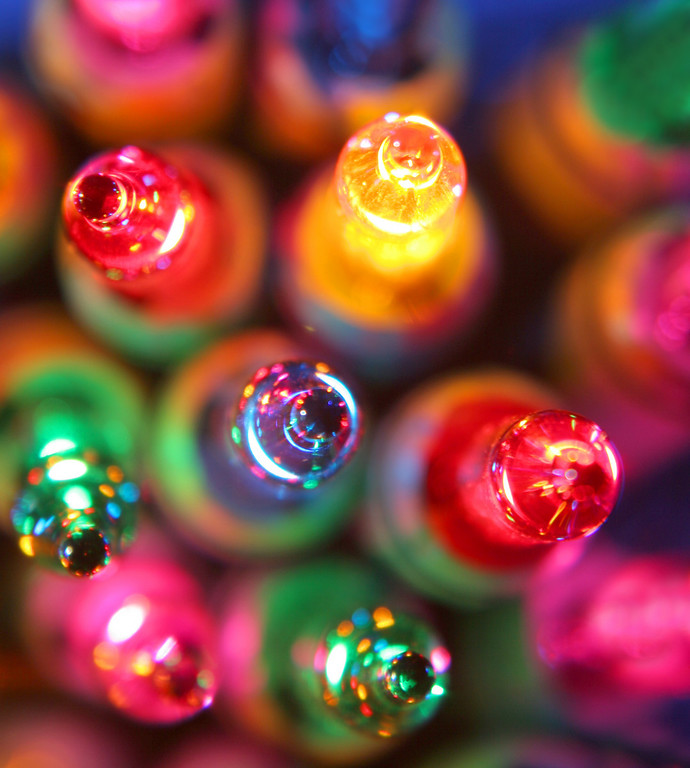 The tips of christmas bulbs reflect many colors.